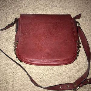 studded maroon purse